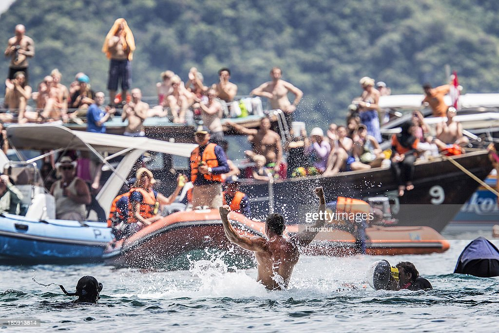 In this handout image provided by Red Bull, Artem Silchenko of Russia bursts from the water after his final dive from the 27 metre platform on Hong Island in the Andaman Sea during the last competition day of the eighth and final stop of the 2013 Red Bull Cliff Diving World Series on October 26, 2013 at Krabi, Thailand.
