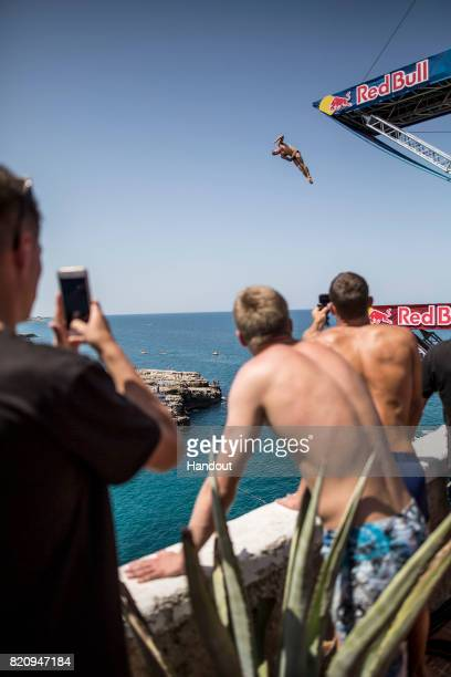 In this handout image provided by Red Bull Artem Silchenko of Russia dives from the 27 metre platform during the first training session of the third...