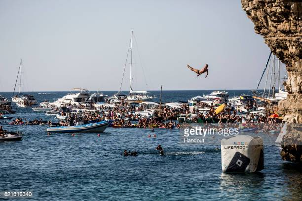 In this handout image provided by Red Bull Artem Silchenko of Russia dives from the 27 platform during the third stop of the Red Bull Cliff Diving...