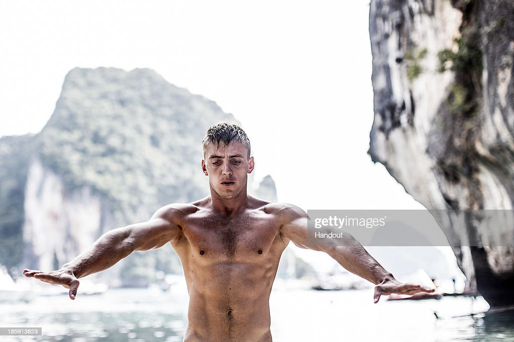 In this handout image provided by Red Bull, Artems Silchenko of Russia warms up on Hong Island in the Andaman Sea during the last competition day of the eighth and final stop of the 2013 Red Bull Cliff Diving World Series on October 26, 2013 at Krabi, Thailand.