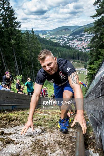 In this handout image provided by Red Bull Artjom Mueller of Germany makes his way up the 400 metre long ski jump course with 140 metres of elevation...