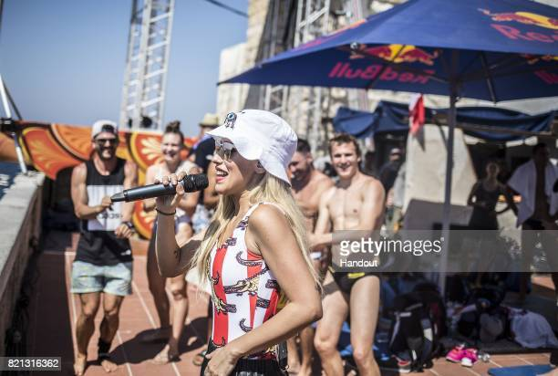 In this handout image provided by Red Bull Baby K performs during the third stop of the Red Bull Cliff Diving World Series on July 23 2017 in...