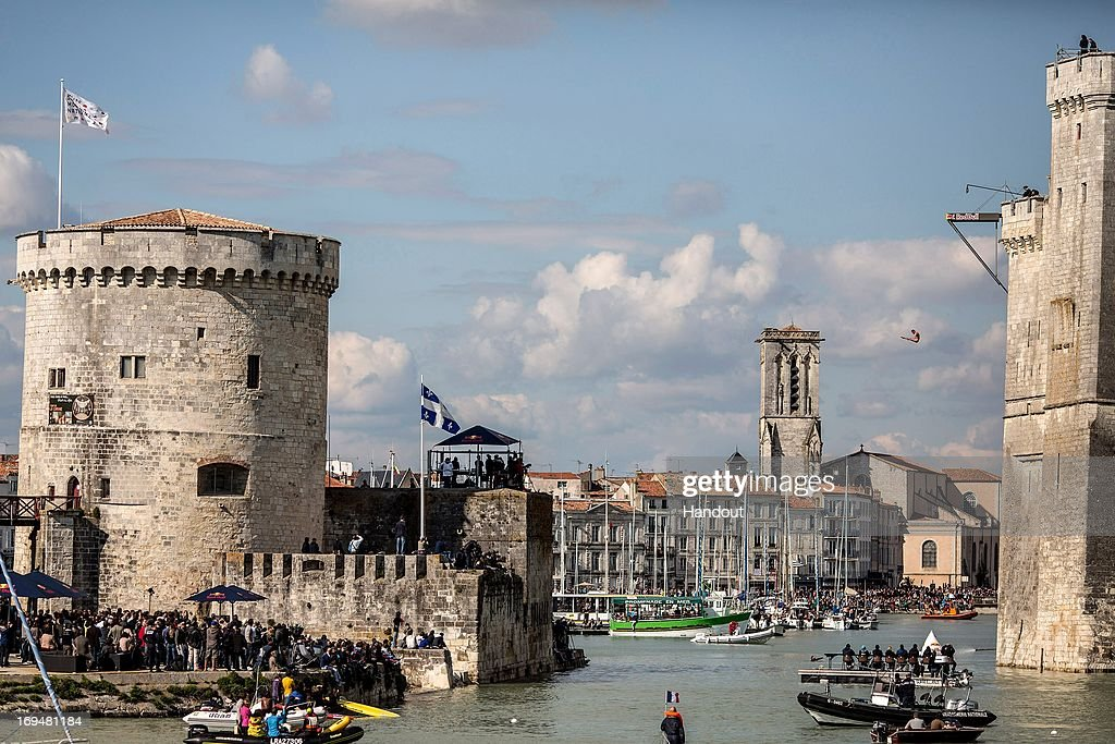 In this handout image provided by Red Bull, Blake Aldridge of the United Kingdom dives from the 27.5 metre platform on the Saint Nicolas Tower during the first stop of the Red Bull Cliff Diving World Series on May 25, 2013 at La Rochelle, France.