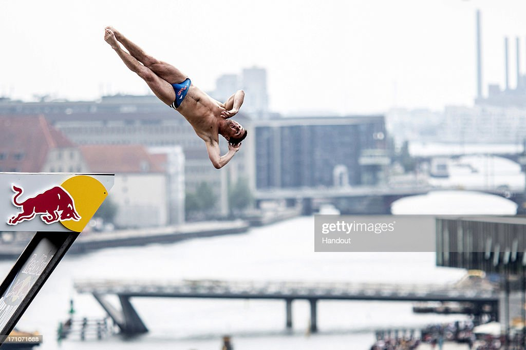 In this handout image provided by Red Bull, Blake Aldridge of the United Kingdom dives from the 28-metre platform at the Copenhagen Opera House during the first round of the second stop of the Red Bull Cliff Diving World Series on June 21, 2013 at Copenhagen, Denmark.