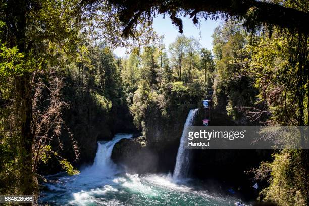 In this handout image provided by Red Bull Blake Aldridge of the UK dives from the 27 metre platform next to Rininahue waterfall during the sixth and...