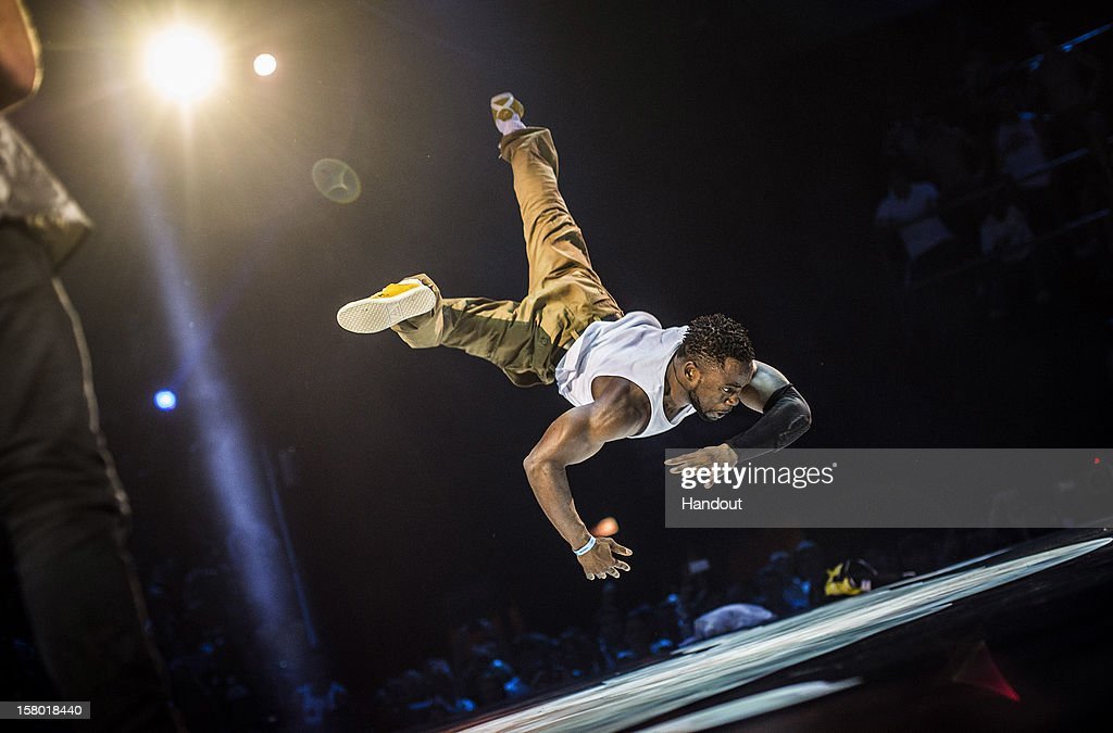 In this handout image provided by Red Bull, Boissilla Banya 'Junior' of France performs against David 'Kid David' Shreibman of the USA during the Red Bull BC One breakdancing world finals at the Fundicao Progresso on December 8, 2012 in Rio de Janeiro, Brazil.