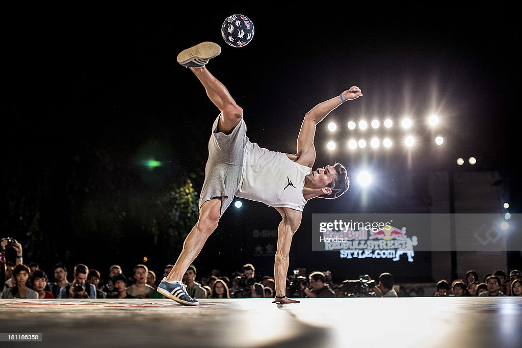 In this handout image provided by Red Bull, Carlos Iacono of Argentina competes at Zojoji Temple during the Red Bull Street Style freestyle football world finals on September 19, 2013 at Tokyo, Japan.