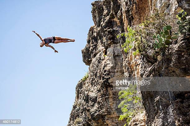 In this handout image provided by Red Bull Cesilie Carlton of the USA dives from the 20 metre platform at Hells Gate during the first training...