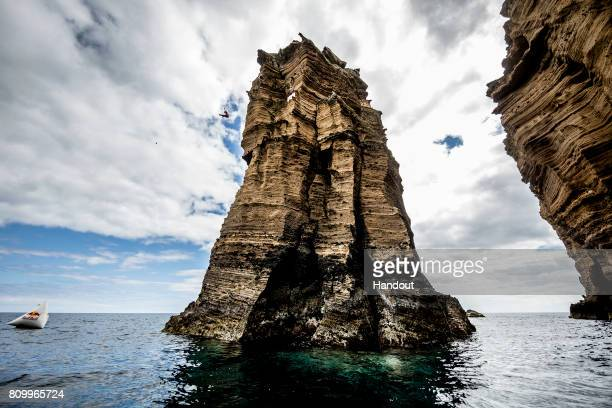 In this handout image provided by Red Bull Cesilie Carlton of the USA dives 23 metres from the rock monolith at Islet Franca do Campo during an...
