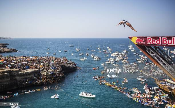 In this handout image provided by Red Bull Cesilie Carlton of the USA dives from the 21 metre platform during the third stop of the Red Bull Cliff...