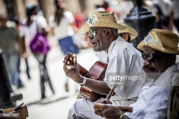 In this handout image provided by Red Bull Cuban musicians play in the streets of Havana prior to the first stop of the Red Bull Cliff Diving World...