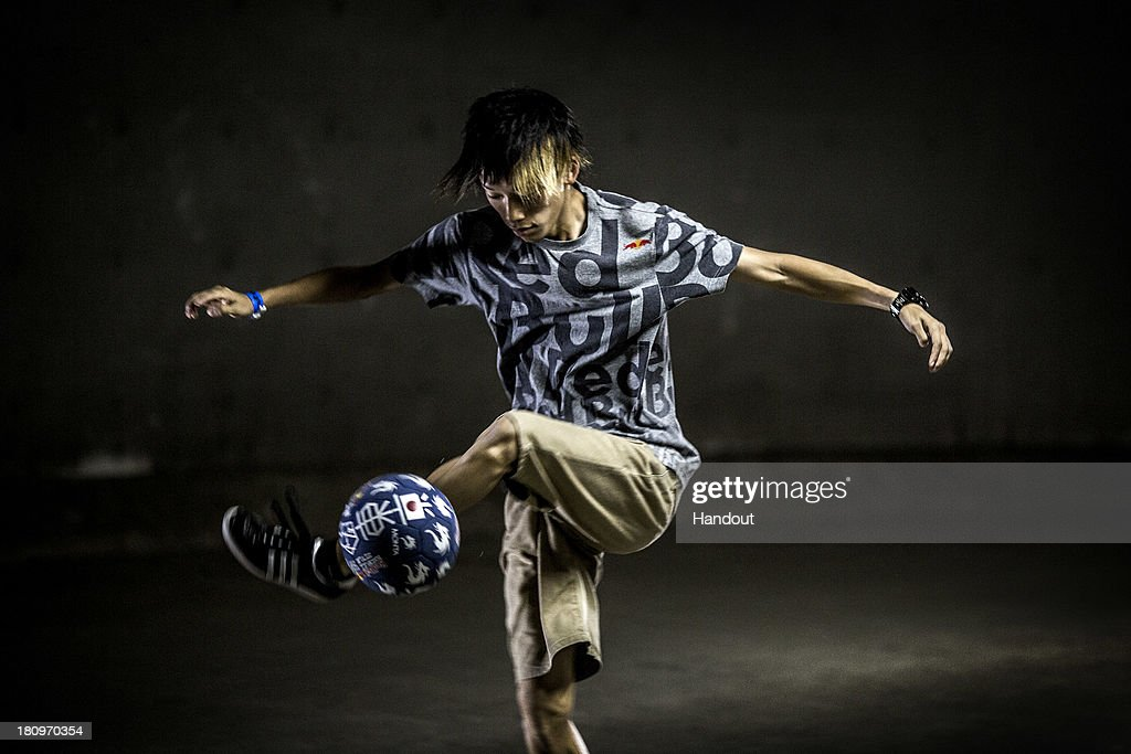 In this handout image provided by Red Bull, Current Street Style world champion, Kotaru Tokuda of Japan practices in a tunnel underneath Zojoji Temple in preparation for the Red Bull Street Style freestyle football world finals on September 17, 2013 in Tokyo, Japan.