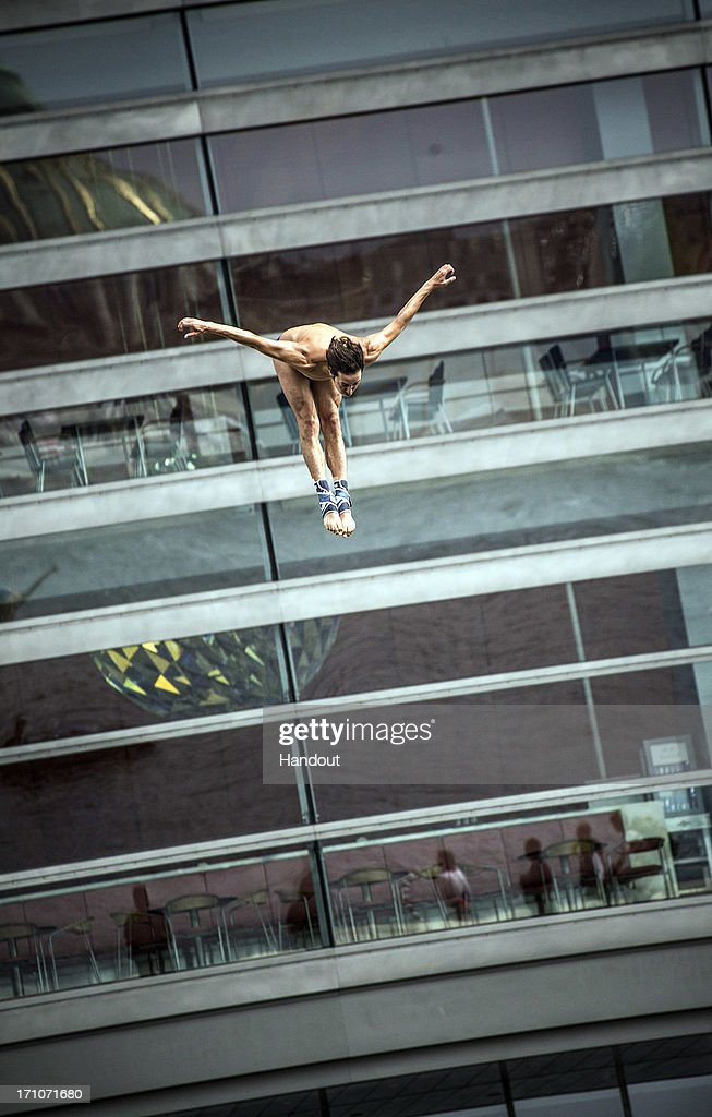 In this handout image provided by Red Bull, Cyrille Oumedjkane of France dives from the 28-metre platform at the Copenhagen Opera House during the first round of the second stop of the Red Bull Cliff Diving World Series on June 21, 2013 at Copenhagen, Denmark.