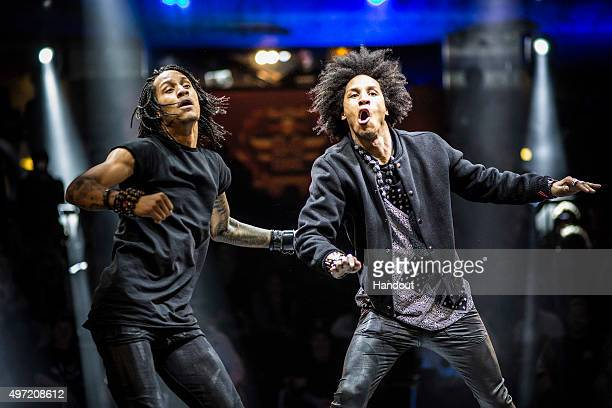 In this handout image provided by Red Bull Dancers Les Twins Laurent Bourgeois and Larry Bourgeois of France perform in a side act during the Red...