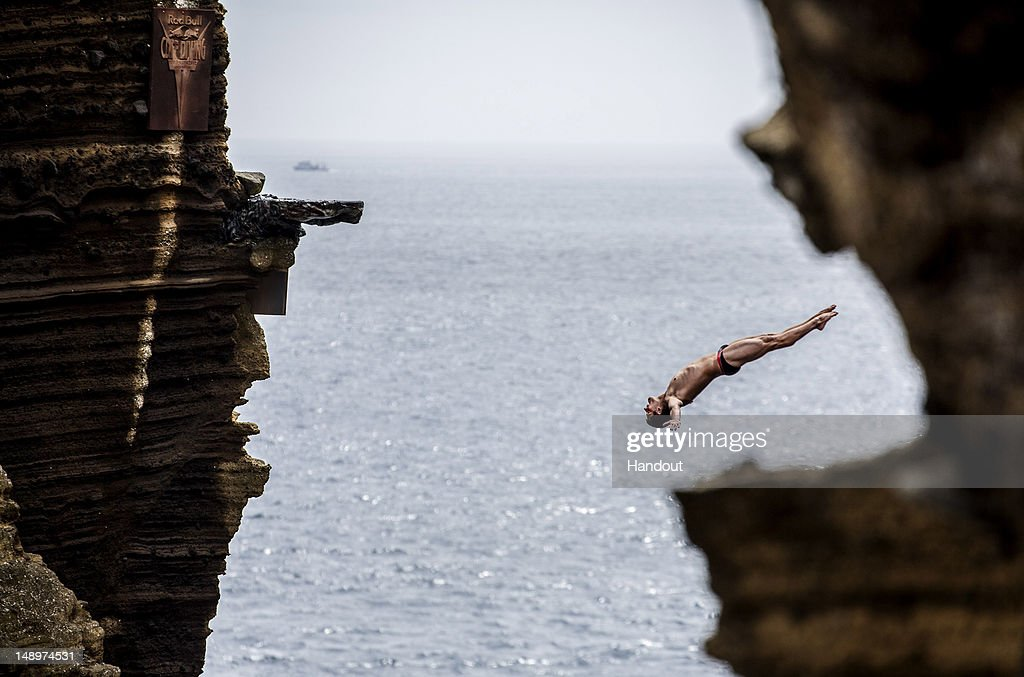 In this handout image provided by Red Bull, David Colturi of the U.S. dives 29 metres from the rock monolith during the first round of the third stop of the Red Bull Cliff Diving World Series on July 20, 2012 in Islet Vila Franca do Campo, Azores, Portugal.
