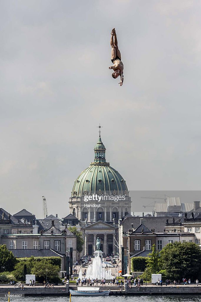 In this handout image provided by Red Bull, David Colturi of the USA dives from the 28 metre platform on the roof of the Copenhagen Opera House during the first practice session of second stop of the Red Bull Cliff Diving World Series on June 20, 2013 at Copenhagen, Denmark.