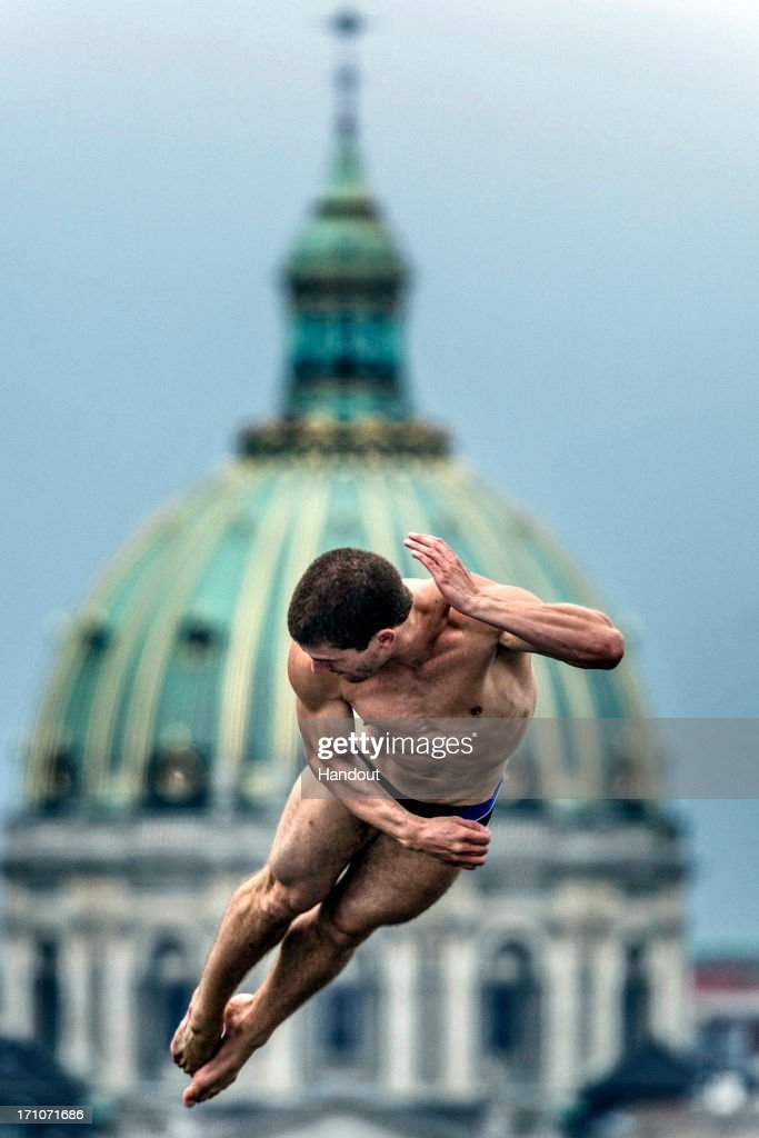 In this handout image provided by Red Bull, David Colturi of the USA dives from the 28-metre platform at the Copenhagen Opera House during the second practice session of the second stop of the Red Bull Cliff Diving World Series on June 21, 2013 at Copenhagen, Denmark.