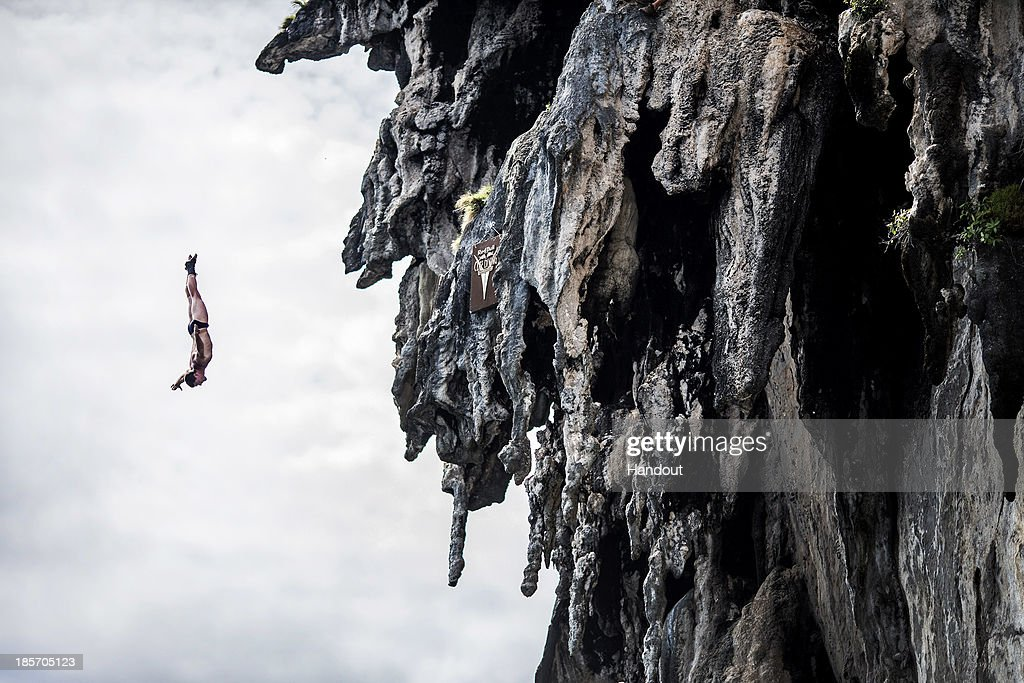 In this handout image provided by Red Bull, David Colturi of the USA dives from a 25 metre rock at Viking Caves in the Andaman Sea during competition on the fifth day of the final stop of the 2013 Red Bull Cliff Diving World Series on October 24, 2013 at Phi Phi Island, Thailand.
