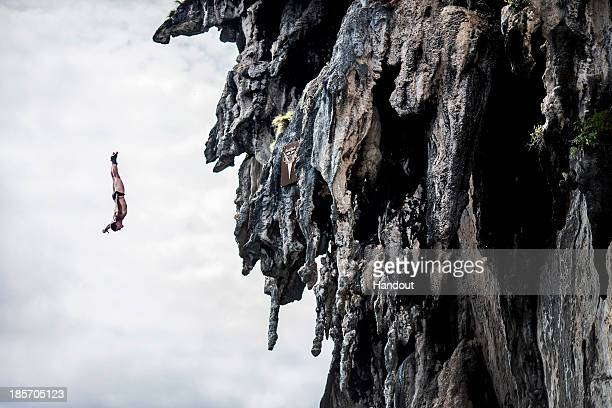 In this handout image provided by Red Bull David Colturi of the USA dives from a 25 metre rock at Viking Caves in the Andaman Sea during competition...