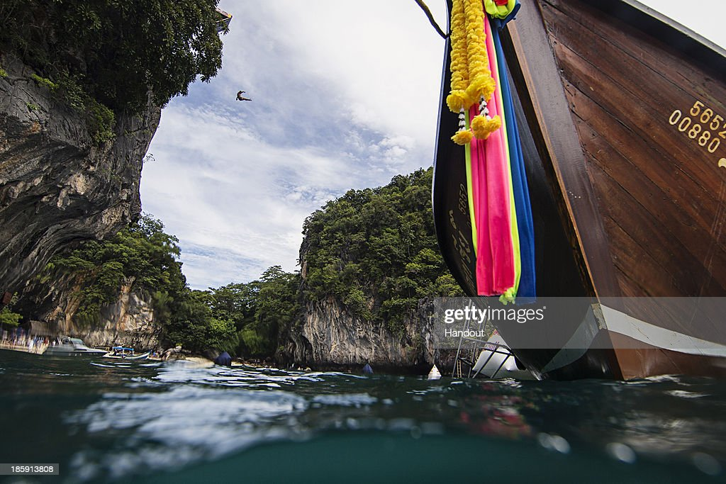In this handout image provided by Red Bull, David Colturi of the USA dives from the 27 metre platform on Hong Island in the Andaman Sea during the last competition day of the eighth and final stop of the 2013 Red Bull Cliff Diving World Series on October 26, 2013 at Krabi, Thailand.