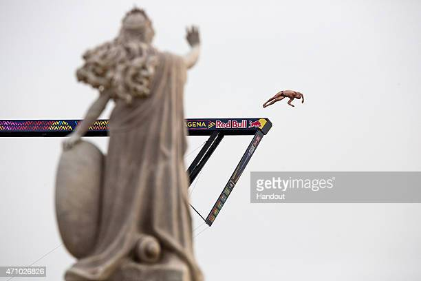 In this handout image provided by Red Bull David Colturi of the USA dives from the 275 metre platform during the second training session of the first...