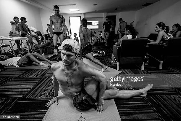 In this handout image provided by Red Bull David Colturi of the USA stretches in the athletes room prior to the seeding round of the first stop of...