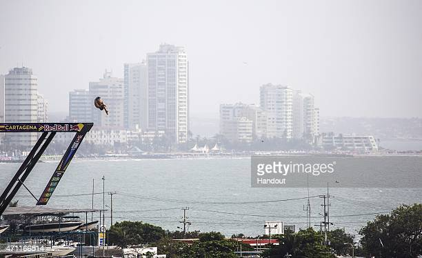 In this handout image provided by Red Bull David Colturi of the USA dives from the 275 metre platform on the Cartegena Convention Centre during the...
