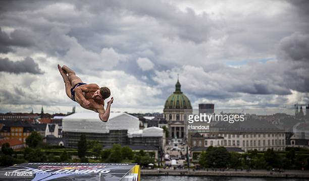 In this handout image provided by Red Bull David Colturi of the USA dives from the 28 metre platform on the Copenhagen Opera House during the first...