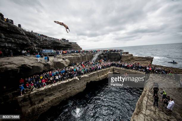 In this handout image provided by Red Bull David Colturi of the USA dives from the 275 metre platform at the Serpent`s Lair during the first stop of...