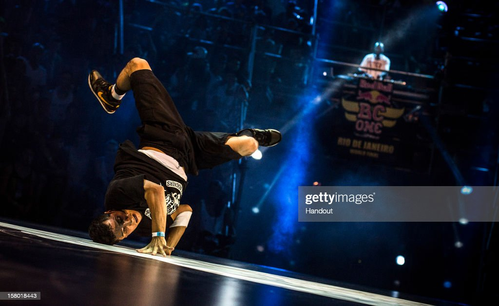In this handout image provided by Red Bull, defending champion, Omar 'Roxrite' Delgado of the USA, performs during the Red Bull BC One breakdancing world finals at the Fundicao Progresso on December 8, 2012 in Rio de Janeiro, Brazil.