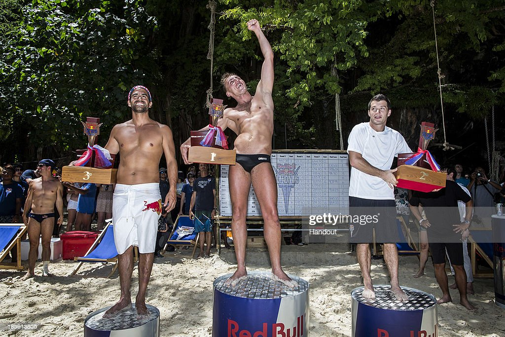 In this handout image provided by Red Bull, event and series winner Artem Silchenko (C) of Russia celebrates on the podium with 2nd placed Steven LoBue (R) of the USA and 3rd placed Orlando Duque (L) of Colombia on Hong Island in the Andaman Sea during the last competition day of the eighth and final stop of the 2013 Red Bull Cliff Diving World Series on October 26, 2013 at Krabi, Thailand.