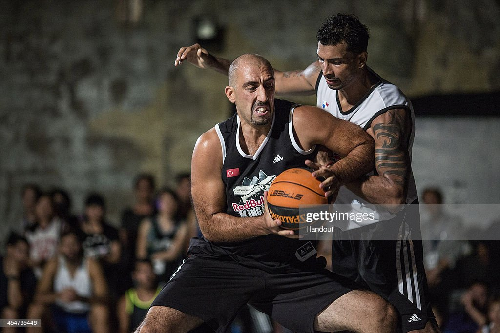 In this handout image provided by Red Bull, event winner Kivanc Dinler (L) of Turkey plays one-on-one basketball against <a gi-track='captionPersonalityLinkClicked' href=/galleries/search?phrase=Orlando+Ortega&family=editorial&specificpeople=7863118 ng-click='$event.stopPropagation()'>Orlando Ortega</a> (R) of Panama during the Red Bull King of the Rock World Finals at Green Island Human Rights Memorial Park on September 6, 2014 on Samasana Island, Taiwan.