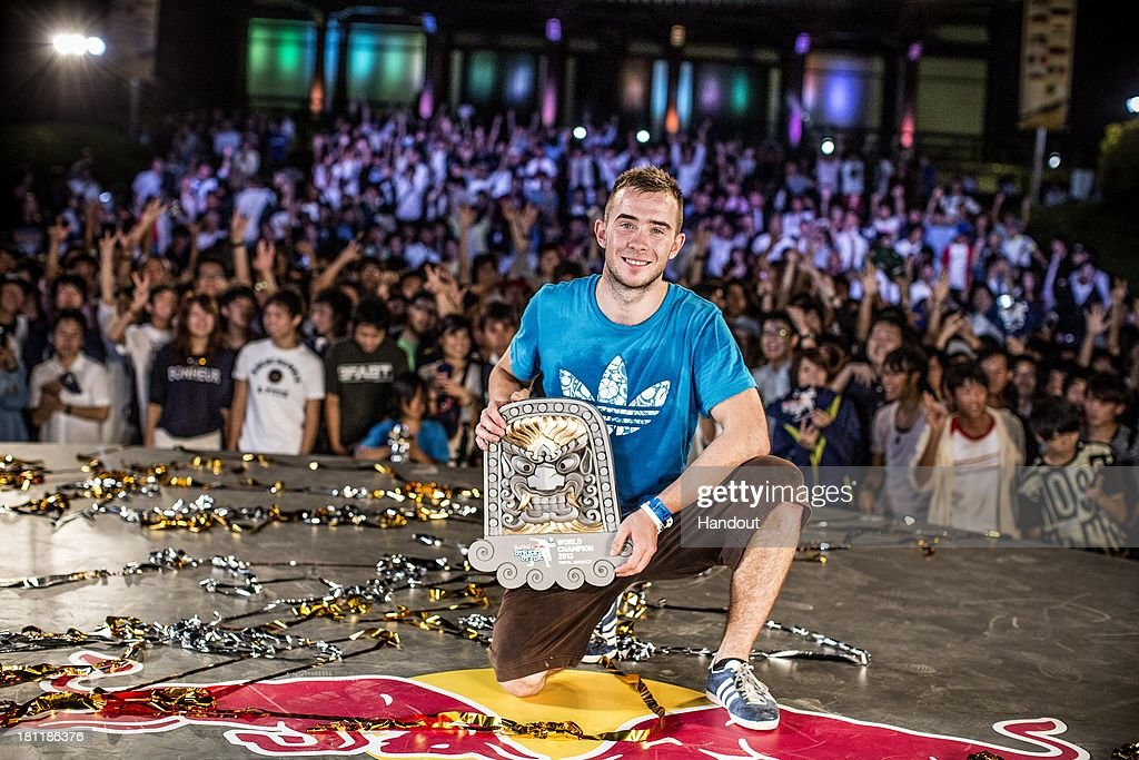 In this handout image provided by Red Bull, event winner, Szymon Skalski of Poland with the winners trophy at Zojoji Temple during the Red Bull Street Style freestyle football world finals on September 19, 2013 at Tokyo, Japan.