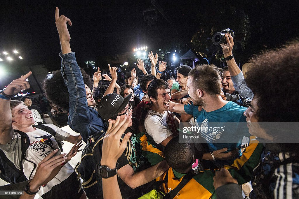 In this handout image provided by Red Bull, event winner Szymon Skalski (R-Blue shirt) of Poland is congratulated by the other athletes at Zojoji Temple after winning the Red Bull Street Style freestyle football world finals on September 19, 2013 at Tokyo, Japan.