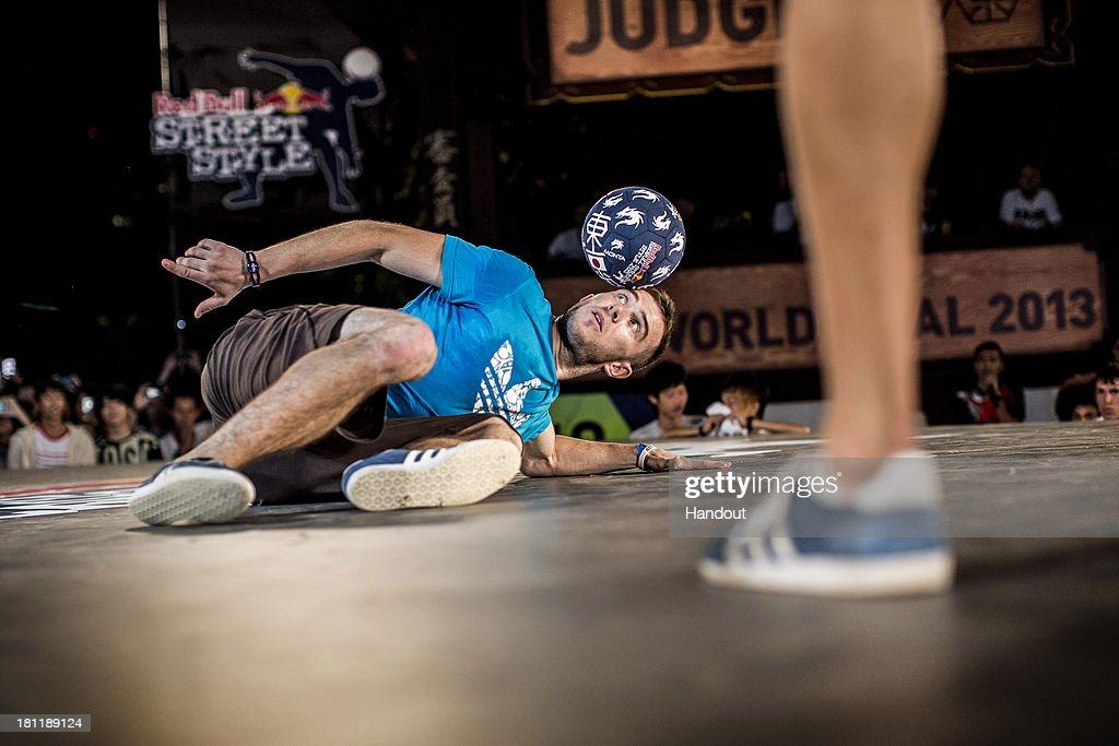 In this handout image provided by Red Bull, event winner, Szymon Skalski of Poland competes at Zojoji Temple during the Red Bull Street Style freestyle football world finals on September 19, 2013 at Tokyo, Japan.