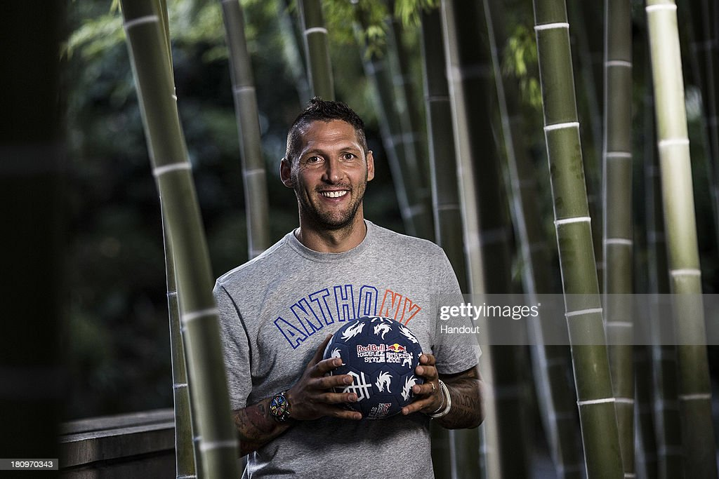 In this handout image provided by Red Bull, Former Italian national football player, Marco Materazzi, poses for a portrait at Zojoji Temple before taking up his role as judge for the Red Bull Street Style freestyle football world finals on September 18, 2013 in Tokyo, Japan.