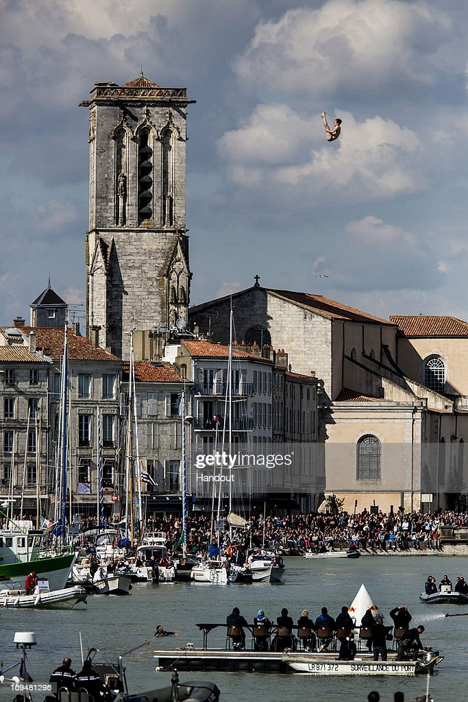 In this handout image provided by Red Bull, Gary Hunt of Great Britain dives from the 27.5 metre platform on the Saint Nicolas Tower during the first stop of the Red Bull Cliff Diving World Series on May 25, 2013 at La Rochelle, France.