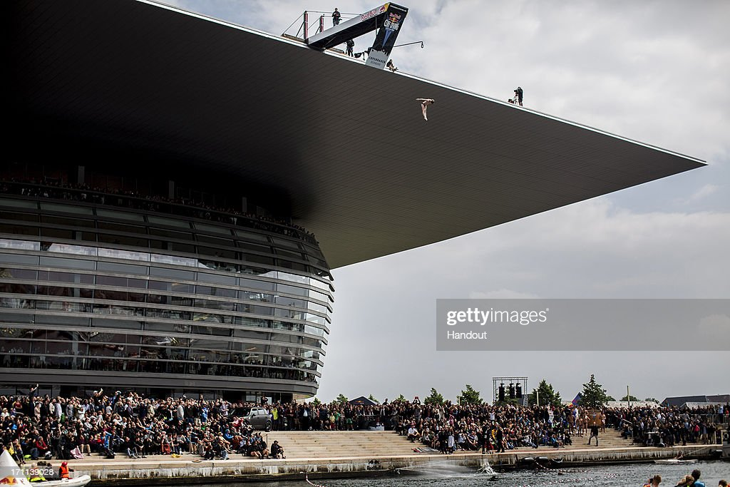 In this handout image provided by Red Bull, Gary Hunt of the UK dives from the 28 metre platform at the Copenhagen Opera House during the second stop of the Red Bull Cliff Diving World Series on June 22, 2013 at Copenhagen, Denmark.