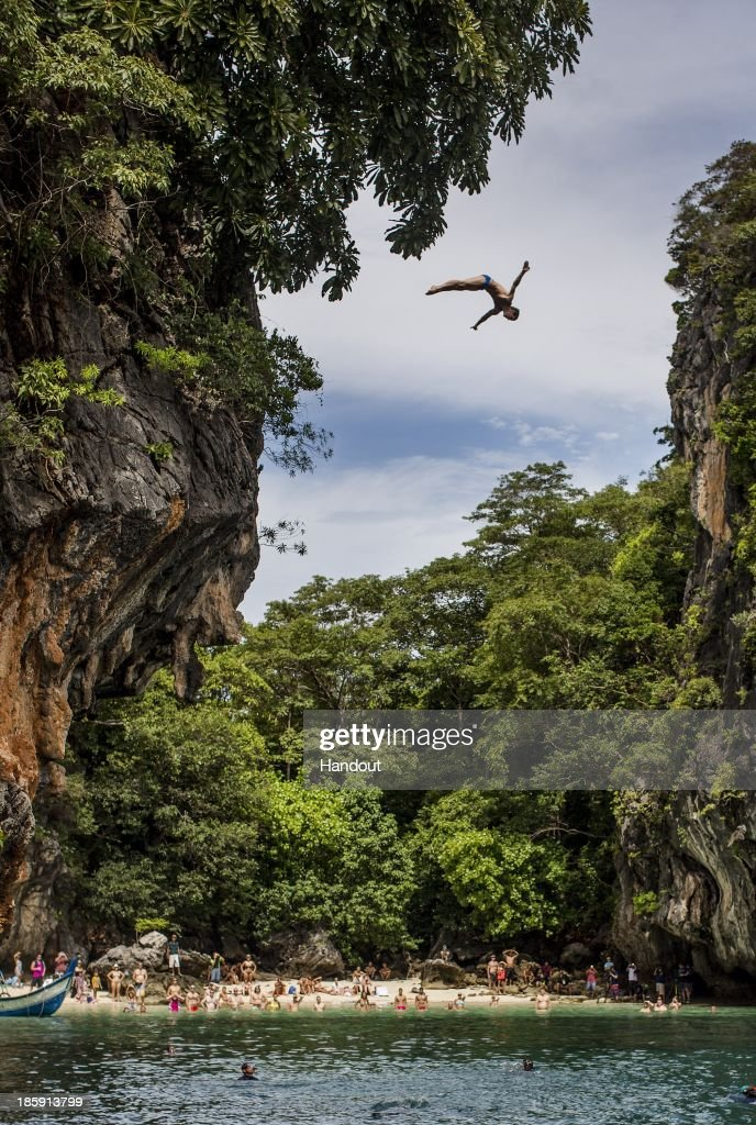 In this handout image provided by Red Bull, Gary Hunt of the UK dives from the 27 metre platform on Hong Island in the Andaman Sea during the last competition day of the eighth and final stop of the 2013 Red Bull Cliff Diving World Series on October 26, 2013 at Krabi, Thailand.