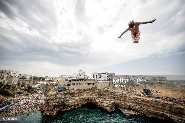 In this handout image provided by Red Bull Gary Hunt of the UK dives from the 27 metre platform during the first competition day of the third stop of...