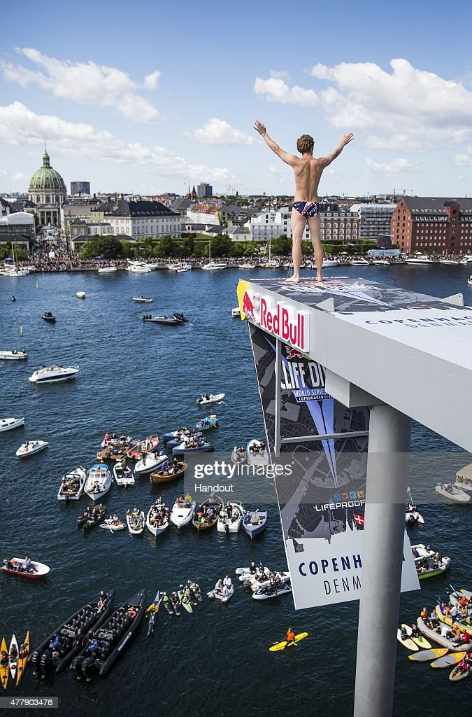 In this handout image provided by Red Bull, Gary Hunt of the UK acknowledges the crowd before diving from the 28 metre platform on the Copenhagen Opera House during the fourth stop of the Red Bull Cliff Diving World Series, Copenhagen, Denmark.