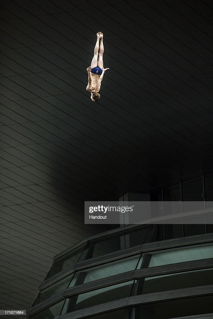 In this handout image provided by Red Bull, Gary Hunt of the United Kingdom dives from the 28-metre platform at the Copenhagen Opera House during the first round of the second stop of the Red Bull Cliff Diving World Series on June 21, 2013 at Copenhagen, Denmark.