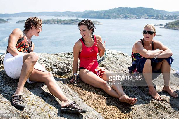 In this handout image provided by Red Bull Ginger Huber of the United States Anna Bader of Germany and Cesilie Carlton of the United States relax...