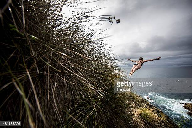 In this handout image provided by Red Bull Ginger Huber of the USA dives from a 20 metre cliff during the first round of the fifth stop of the Red...