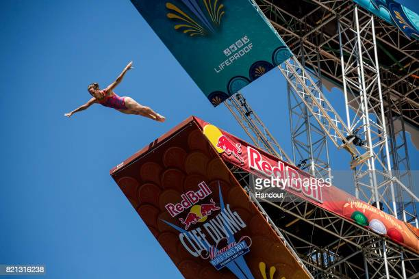 In this handout image provided by Red Bull Ginger Huber of the USA dives from the 21 platform during the third stop of the Red Bull Cliff Diving...