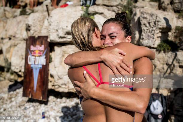 In this handout image provided by Red Bull Jacqueline Valente of Brazil and Rhiannan Iffland of Australia congratulate one another during the third...