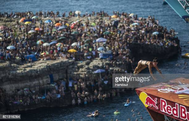 In this handout image provided by Red Bull Jacqueline Valente of Brazil dives from the 21 platform during the third stop of the Red Bull Cliff Diving...