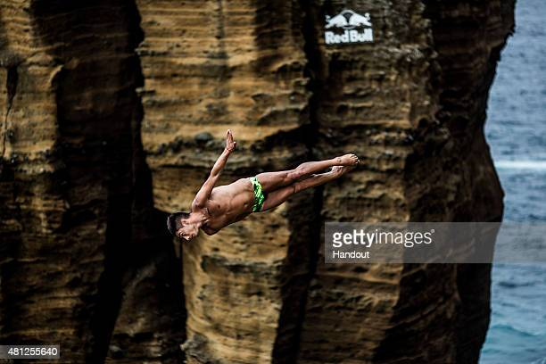 In this handout image provided by Red Bull Jonathan Paredes of Mexico dives from the 27 metre cliff face during the fifth stop of the Red Bull Cliff...