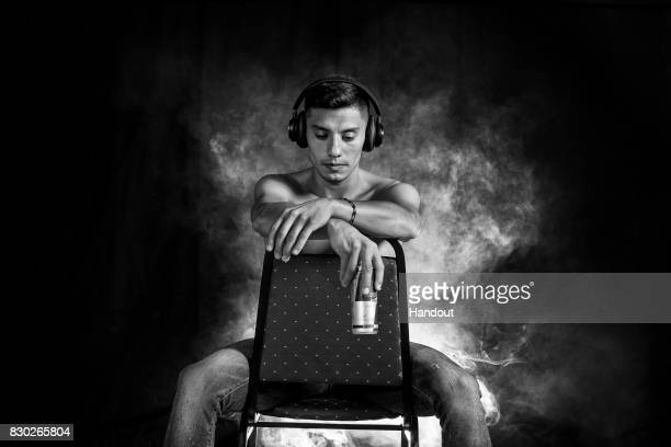 In this handout image provided by Red Bull Jonathan Paredes of Mexico poses for a portrait prior to the first stop of the Red Bull Cliff Diving World...