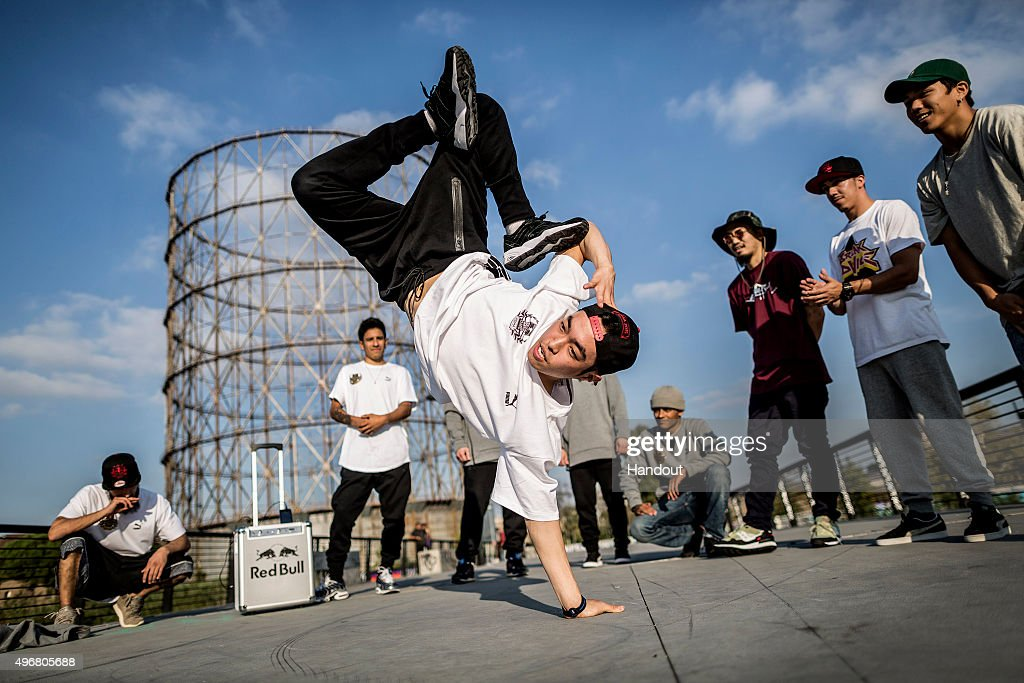 In this handout image provided by Red Bull, Jong Ho 'Leon' Kim of Korea performs as the other B-Boys watch on during a video production prior to this weekend's Red Bull BC One breakdancing world final, on November 11, 2015 in Rome, Italy.